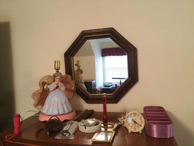 Mirror and contents on top of dresser. Southern belle lamp