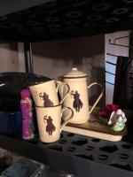 Cowboy coffee set and contents of shelf