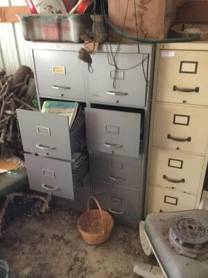 Three metal filing cabinets. 24 in. deep