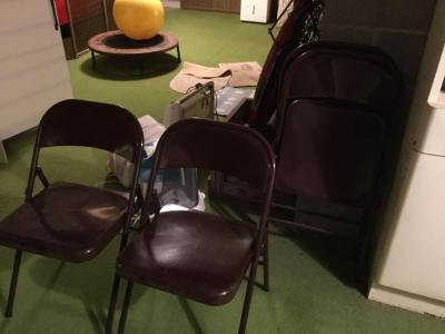 Four brown folding chairs. metal chairs