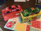 They red number 25 Budweiser car and a green number 18 interstate car