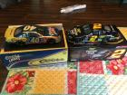 Number 40 Coors light yellow and blue car and a number 2miller car