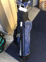 Blue golf bag and assorted clubs