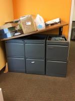 Three 2 drawer file cabinets and wood top no contents
