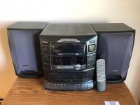 Fisher stereo with cassette and CD player, small microwave type cabinet