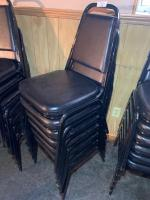 6-Black stack-able chairs
