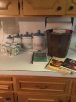 Canister set, mugs and cookbooks