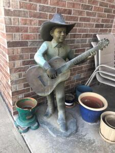 "Guitar player. Bronze. 52"" tall"