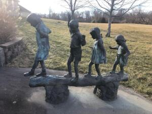 "Kids on a log. Bronze. 76"" x 62"""