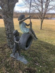"Tire swing. 34""x74"" bronze"