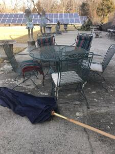 "48"" metal table. Five chairs and umbrella"