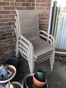 Group of four tan lawn chairs