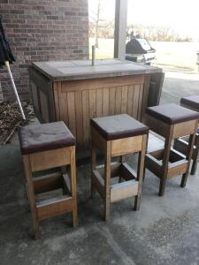 Outdoor bar, stools and umbrella. Bar needs some work. 42 x 36""