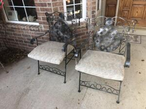 A group of four metal patio chairs