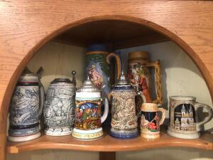 Eight beer Steins on a shelf