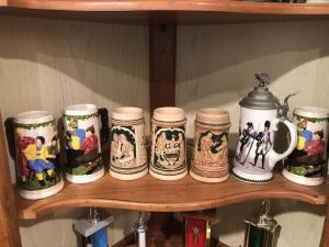 Seven beer Steins on middle shelf
