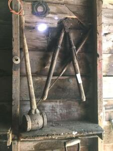 Vintage sledge, tools in smokehouse.