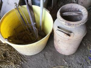 Milk can and yellow tub of chain and tools.