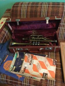 Mid-America Trumpet with case and books.