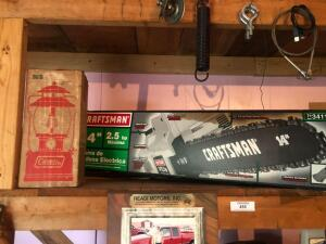 Contents of shelf, craftsman chain saw, Coleman lantern