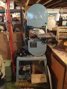 Delta band saw with spare band saw parts