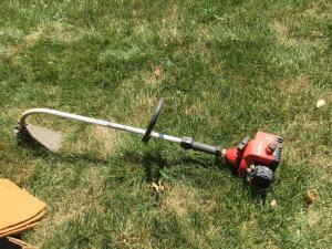 A curved shaft string trimmer. Not tested.