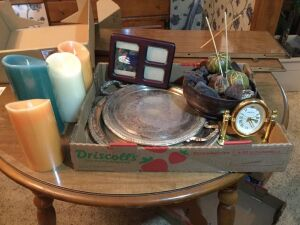 Silver trays, clock, frame and battery candles