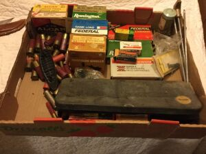 Miscellaneous rifle shells shotgun shells and gun cleaning kit