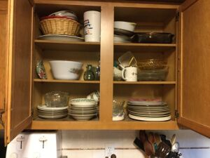 Dishes and contents of cabinet