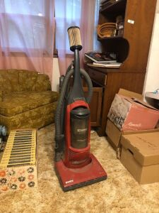 Red Kenmore vacuum cleaner