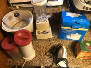 Crockpot, blender, slow cooker, iron. Contents of middle two steps