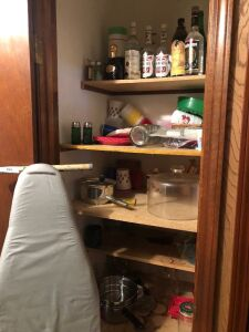 Ironing board, pots and pans, contents of closet