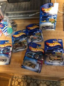 Hot wheels still in packages.