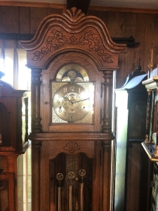 Howard Miller grandfather clock. 86 inches tall (lot tag 1)