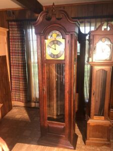 Howard Miller grandfather clock. 80 inches tall. (lot tag 2)