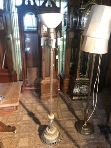 Vintage 60 inch floor lamp with marble on it.