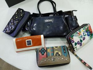 4 clutch purses and one large purse