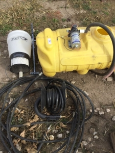 Yellow 25 gallon sprayer tank and hose. Seed shine applicator.