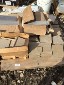 A pallet of beige and gray tiles. 6 inch squares and free by 12 inch rectangles