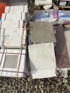 Pallet of mostly 12 inch tiles. Off-white and a gray