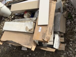 A pallet of 6 1/2? x 24? tiles. Off-white and beige.