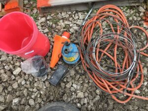 Heavy extension cord, pump, drain cleaner