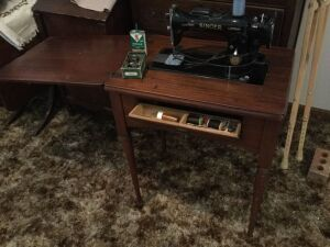 Singer sewing machine and accessories. Oil can is lot 781! By itself.
