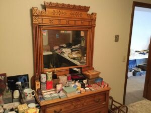 Engraved dresser with mirror. No contents.