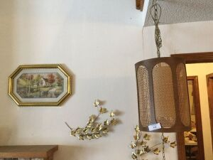 Picture of a house, leaves, hanging lamp.