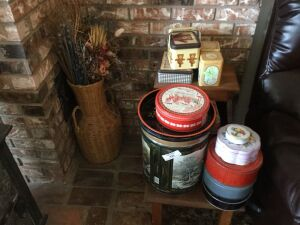 Large group of tins and a 30 inch tall wicker flower arrangement.