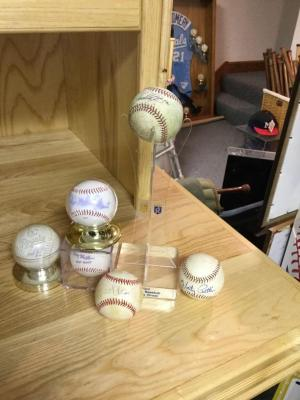 Denny Mathews, Marty Pattin and other autographed baseballs.
