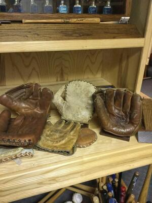 Vintage gloves and stands, Alvin Dark.