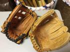 Two George Brett baseball gloves